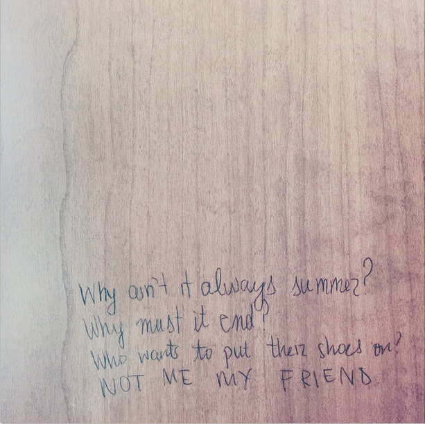 summer poem scribbled into old wooden desk