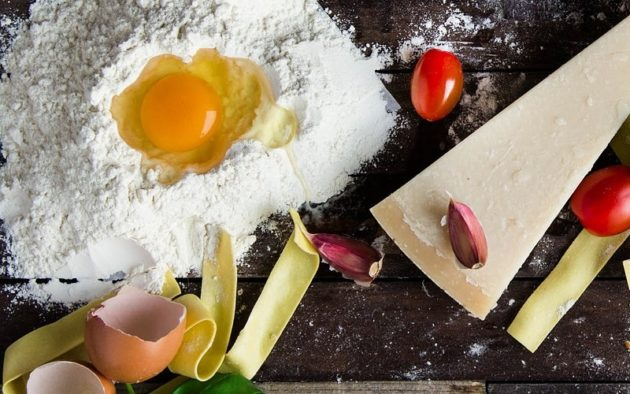 cooking modernist cuisine raw egg in a pile of flour grana padano and fresh pasta