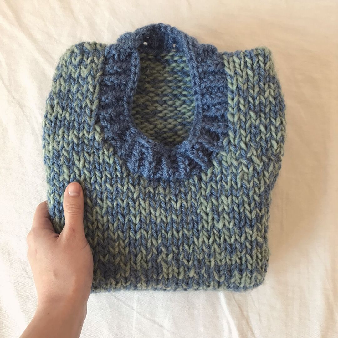 spring knitted vest in bulky yarn, folded