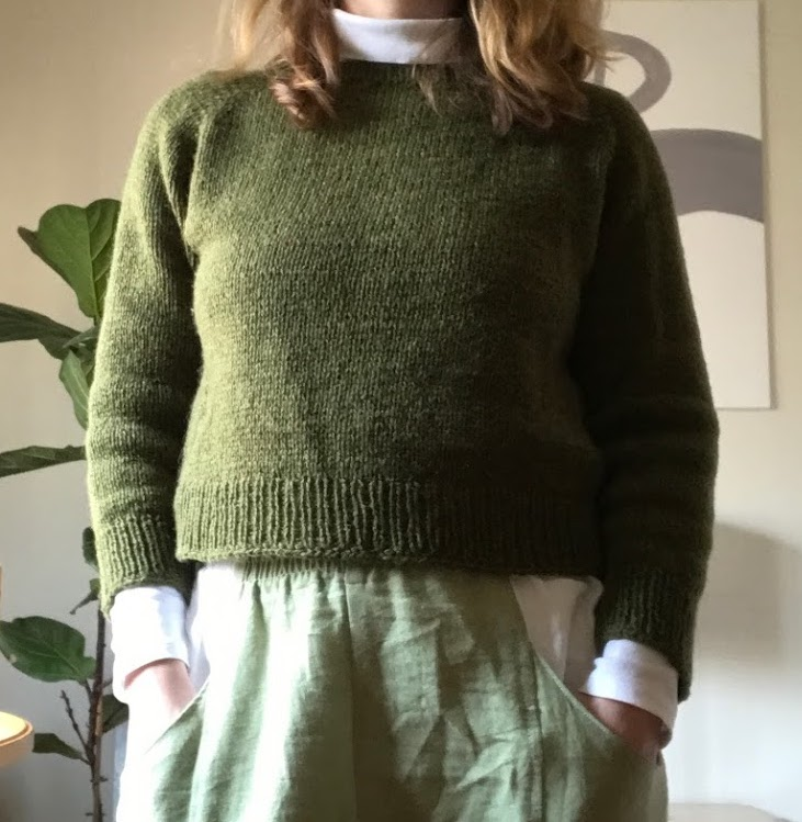 green handknit sweater